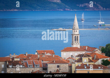 Old Town with bell tower of Saint John the Baptist cathedral in Budva city on the Adriatic Sea coast in Montenegro - Stock Photo