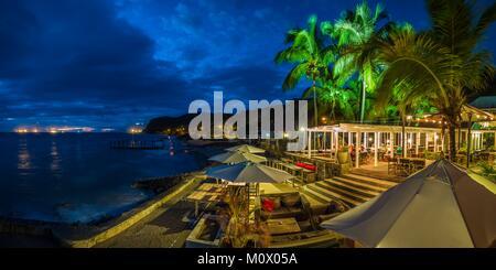 Netherlands,Sint Eustatius,Oranjestad,beachfront restaurant,dusk - Stock Photo
