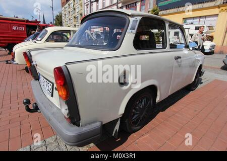 BYTOM, POLAND - SEPTEMBER 12, 2015: People walk by Trabant 601 oldtimer car during 12th Historic Vehicle Rally in - Stock Photo