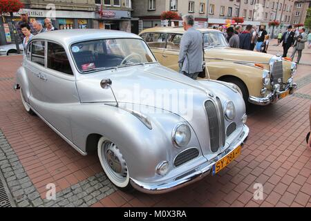 BYTOM, POLAND - SEPTEMBER 12, 2015: People walk by BMW 501 and Mercedes-Benz 300 oldtimer cars during 12th Historic - Stock Photo