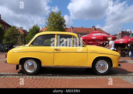 BYTOM, POLAND - SEPTEMBER 12, 2015: People walk by FSO Syrena 105 during 12th Historic Vehicle Rally in Bytom. The - Stock Photo