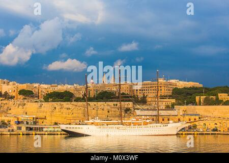 Malta,Valletta,city listed as World Heritage by UNESCO,Grand Harbour,cruising sailboat - Stock Photo