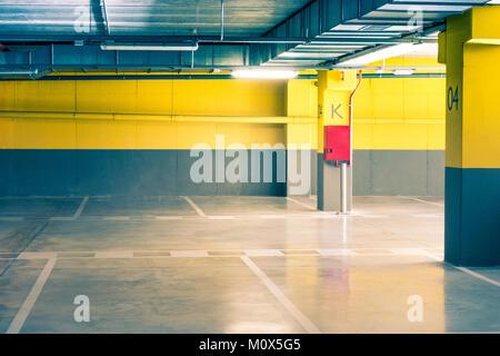 Empty parking underground garage interior in apartment house or in supermarket - Stock Photo