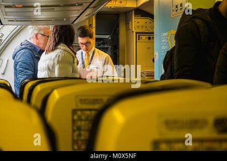 Ryanair cabin crew checking boarding passes as passengers board the aircraft, Dublin airport, Ireland - Stock Photo