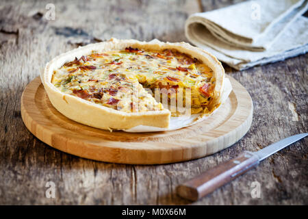 Simple homemade leek onion and bacon pie - Stock Photo