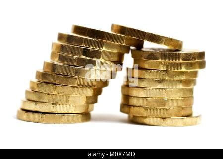 Leaning stack of New one pound coins - Stock Photo