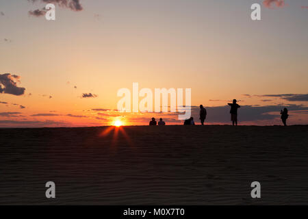 NC01431-00...NORTH CAROLINA - Watching the sunset over Roanoke Sound from a tall sand dune, a popular activity at - Stock Photo