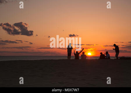 NC01432-00...NORTH CAROLINA - Watching the sunset over Roanoke Sound from a tall sand dune, a popular activity at - Stock Photo