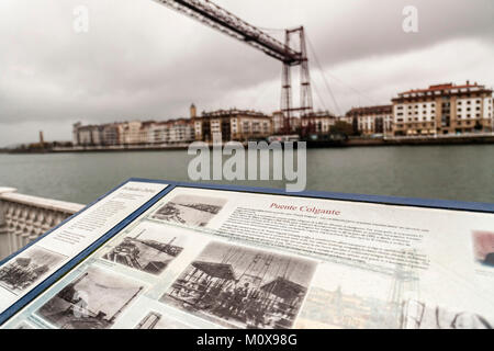 Information sign and Vizcaya bridge, puente colgante view from Portugalete,Basque Country,Spain. - Stock Photo