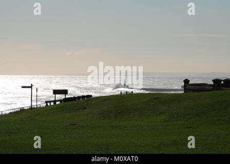 Seaham Harbour lighthouse and pier from clifftop - Stock Photo