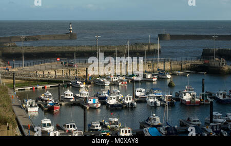 The marina at Seaham Harbour in County Durham showing the harbour and marina entrance and the small boats and yachts - Stock Photo