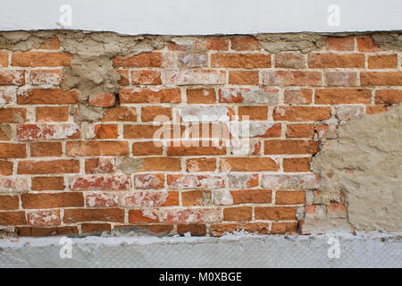 background of an old brick wall with plaster - Stock Photo