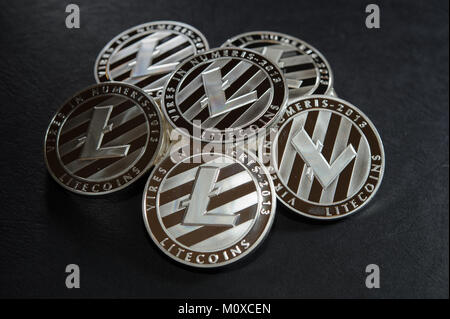 Heap of silver litecoins. Real photo. Virtual cryptocurrency concept. - Stock Photo