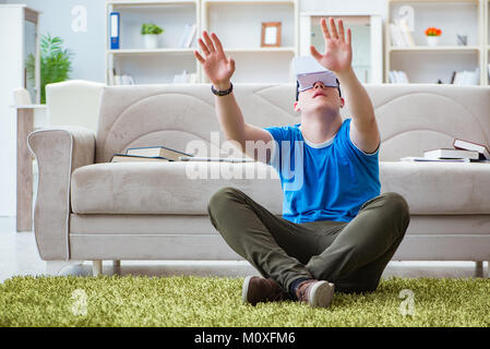 Young man with virtual glasses - Stock Photo
