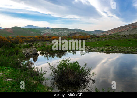 A small lake in the mountains - Stock Photo
