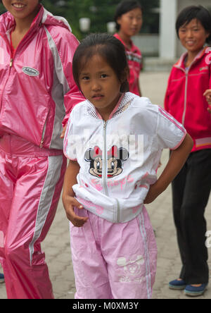 Young North Korean girl with a Minnie mouse logo on her vest in the Songdowon international children's camp, Kangwon - Stock Photo