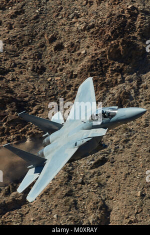 Unmarked F-15E, Strike Eagle, Jet Fighter Bomber, Flying At High Speed And Low Level Through Rainbow Canyon, California. - Stock Photo