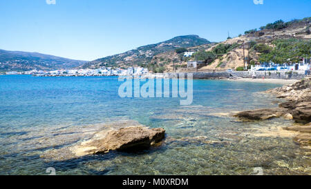 Landscape view looking back towards Korthi town (Ormos Korthiou) showing coast and inland hills of Andros, Greece. - Stock Photo