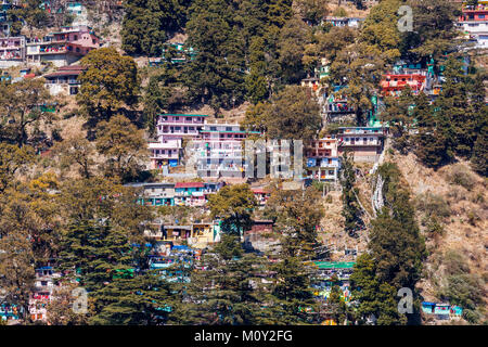 Town view: colourful small houses precariously built on the hillside, Nainital, Uttarakhand, northern India, in the Himalayan Kumaon foothills