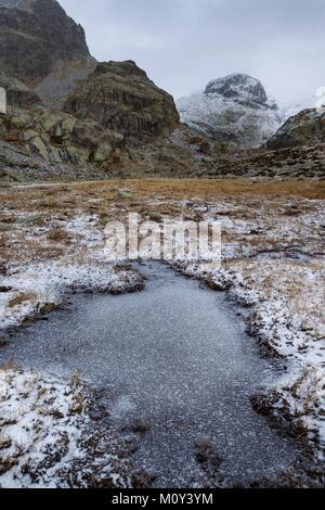 France,Alpes-Maritimes,Mercantour National Park,Gordolasque Valley,frozen water and first snow - Stock Photo