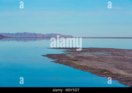 A spit of land with vast shallow flooded salt flats at the Bonneville Salt Flats, which is BLM land west of the - Stock Photo