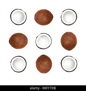 Coconut Flat lay Whole coconuts in peel and halves of coconuts are lying on white background Top view Trendy minimalistic - Stock Photo