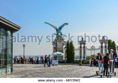 A bronze statue of an eagle clutching a sword at Buda Castle Hill District in Budapest Hungary - Stock Photo