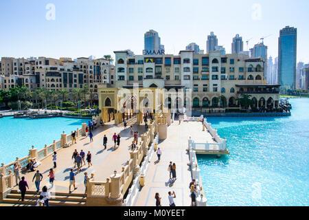 DUBAI, UNITED ARAB EMIRATES - OCTOBER 13, 2017: Dubai mall fountain pool with many people walking to see Burj Khalifa - Stock Photo