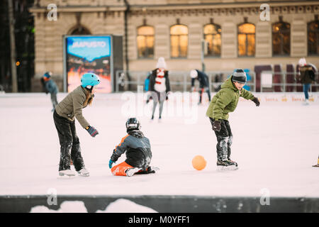 Helsinki, Finland - December 11, 2016: Children Skating On Rink On Railway Square In Winter Day. - Stock Photo