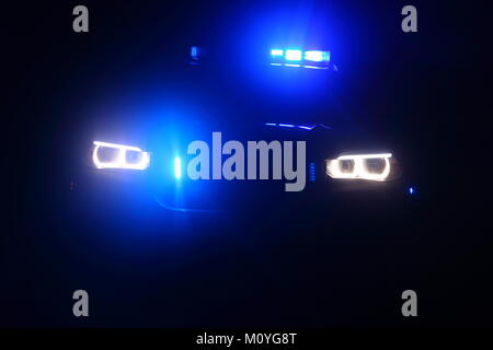 Abstract blue lights on a BMW X5 police car in Doncaster, South Yorkshire. - Stock Photo
