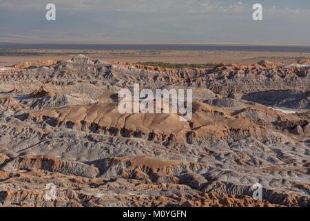 Bizarre red rock formations with white salt,Valle de la Luna,San Pedro de Atacama,Chile - Stock Photo