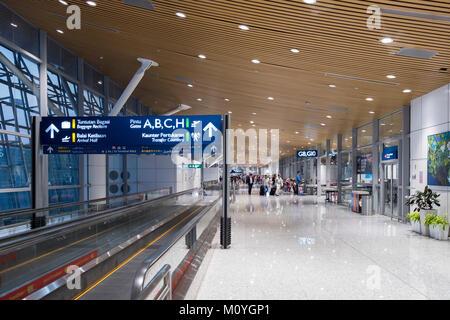 Travelator outside departure gates in in the Kuala Lumpur International Airport - Stock Photo