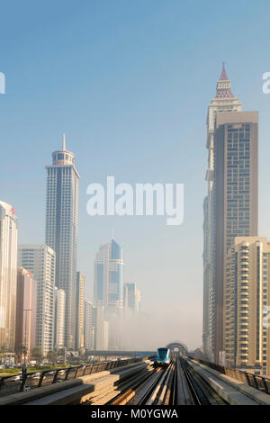 Dubai metro with skyscrapers on either side Stock Photo