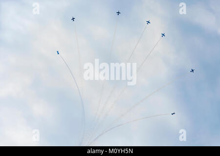 Airplanes on aerobatic show, bright aerobatics with smoke trails. Exciting performance. Air performance, aircrafts, - Stock Photo