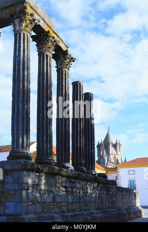 Ruined Roman temple in the main square of Evora city in the Alentejo region of Portugal - Stock Photo
