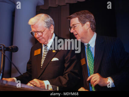 Paul S. Amos (left) and AFLAC CEO Dan Amos at a shareholders meeting. Paul Amos died in 2014. - Stock Photo