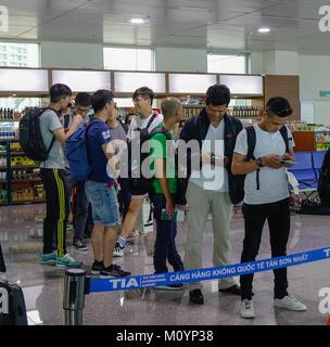 Saigon, Vietnam - Mar 28, 2017. People standing at boarding gate of Tan Son Nhat Airport in Saigon, Vietnam. Tan - Stock Photo