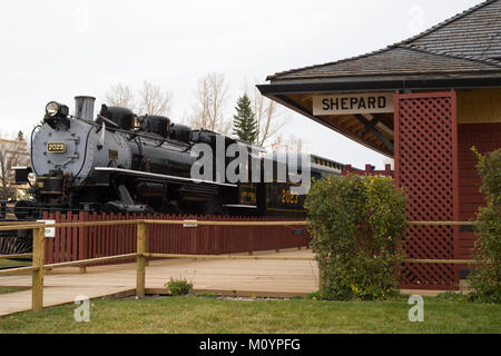 Historic steam train at Shepard station, built in 1910 as a small unmanned railway flag station, now in Heritage - Stock Photo