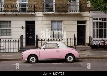 A pink Nissan Firago car parked in London - Stock Photo