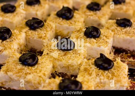 Turkish dessert with the black chocolate and white cream. Sliced cake. - Stock Photo