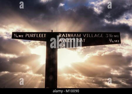 Purfleet Essex. Rays of sunshine on Riverside sign on the Thames path next to the estuary.Directions to Rainham - Stock Photo