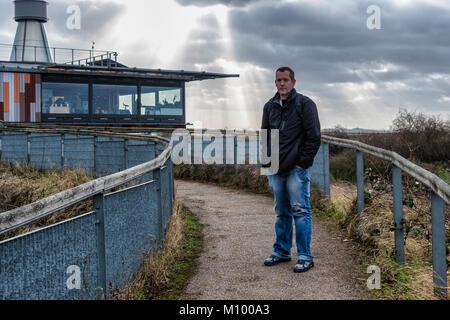 Essex UK. Man outside Visitor Centre of Rainham Marshes RSPB nature reserve next to Thames Estuary in Purfleet, - Stock Photo