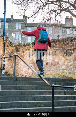 Vennel, Grassmarket, Old Town, Edinburgh, Scotland, United Kingdom, 24th January 2018. Young man practising balancing - Stock Photo