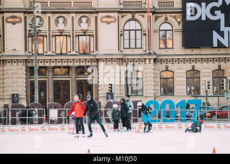Helsinki, Finland - December 11, 2016: Young People And Children Skating On Rink On Railway Square In Winter Day. - Stock Photo