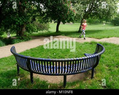 Runner training on steps in Roundhay Park, Leeds, West Yorkshire, England, UK - Stock Photo