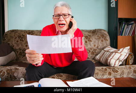 Banking fraud, old woman shouting - Stock Photo
