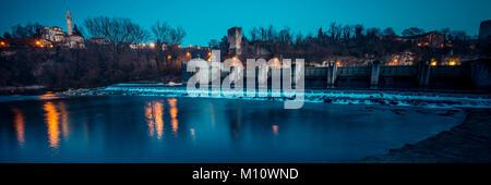dam on the river at dusk - Adda river - italian landscape panorama - Stock Photo