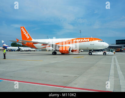 Krakow, Poland - June 27, 2017: EasyJet aircraft Airbus a320 with a pushback tug on the International Balice airport - Stock Photo