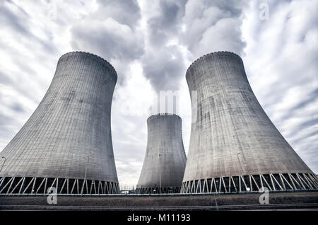 White smoke coming from the cooling towers of the nuclear power plant in Temelin, Czech Republic, Europe - Stock Photo