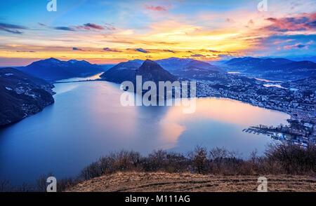Dramatic sunset over Lake Lugano in swiss Alps, Ticino, Switzerland - Stock Photo